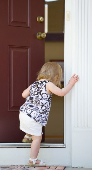 Child entering doorway