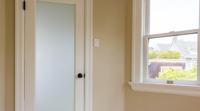 white laminate interior door