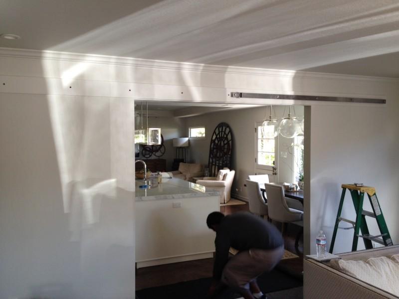 Barn Doors being installed by Interior Door Replacement Company