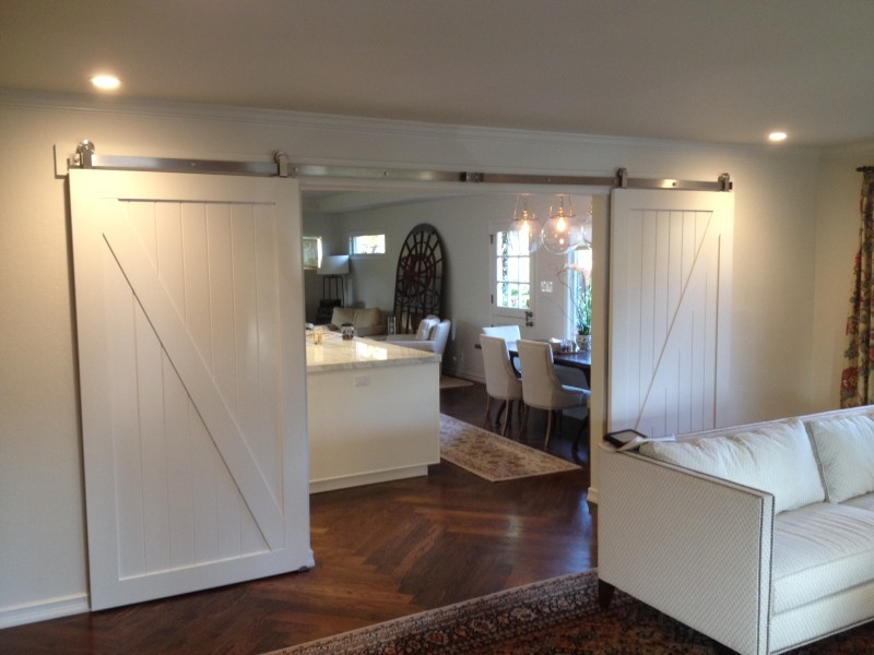 Double barn doors with stainless steel tracks in open position